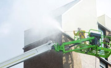 Cleaning an apartment exterior